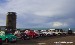 2cv in front of radio tower at the Phare